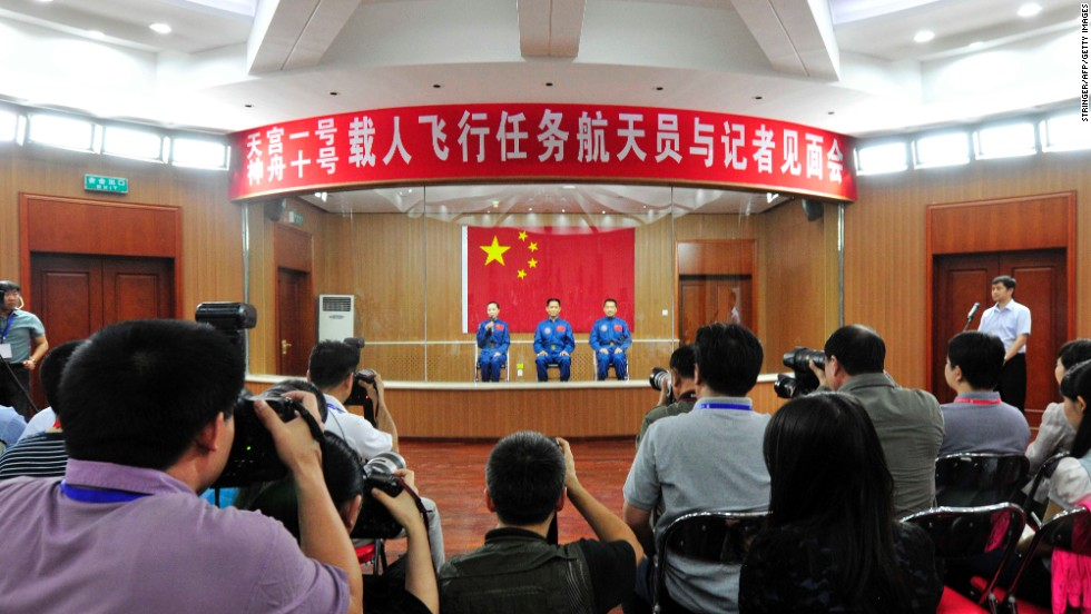 The crew attend a press conference in Jiuquan on Monday, June 10.