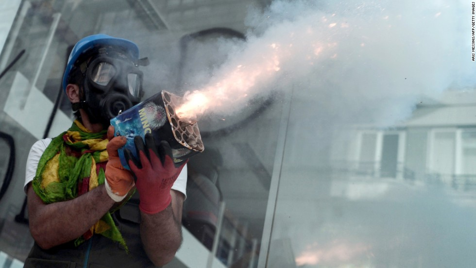 A protester holds fireworks during clashes with riot police in Istabul on June 11.