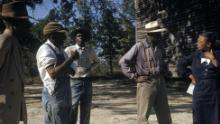 Human test subjects from the Tuskegee syphilis study talking with a study coordinator, Nurse Eunice Rivers, in 1970.
