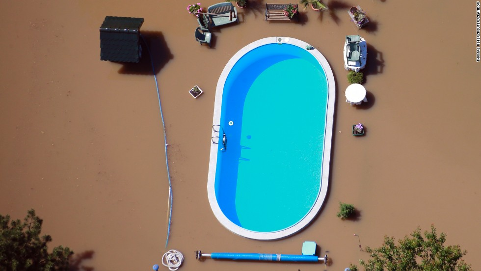 "<a href=""http://www.cnn.com/2013/06/11/world/europe/europe-flood/index.html"">Floodwaters from the Elbe River</a> inundate a yard with a swimming pool near Magdeburg, Germany, on Monday, June 10. Heavy rain has left rivers swollen across Central Europe."