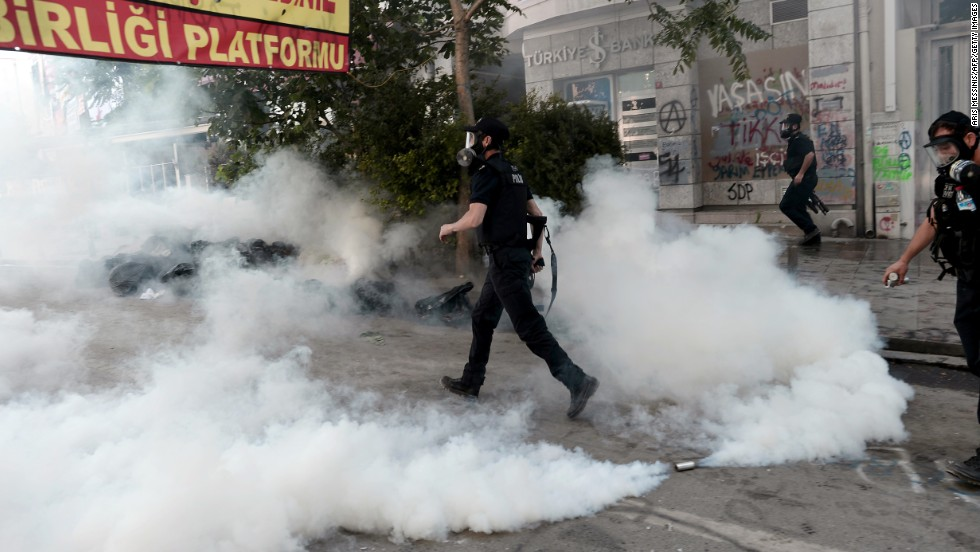 Police enter Taksim Square during clashes with protesters on June 11.
