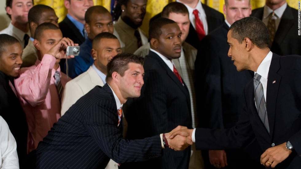 President Barack Obama shakes hands with Tebow at the White House during an April 2009 ceremony that honored the Gators for their national championship.