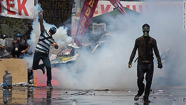 Protestors wear gas masks as riot police use water cannons and tear gas to disperse the crowd during a demonstration near Taksim Square on June 11, 2013 in Istanbul, Turkey.