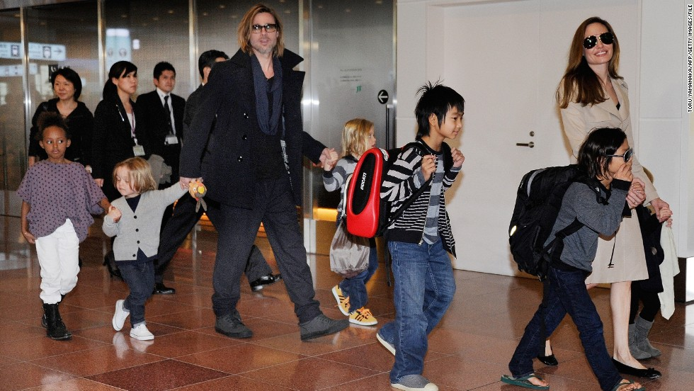 "Brad Pitt and Angelina Jolie have their hands full with six kids. Here they arrive in Tokyo in November 2011 for the Japan premiere of his film ""Moneyball."""