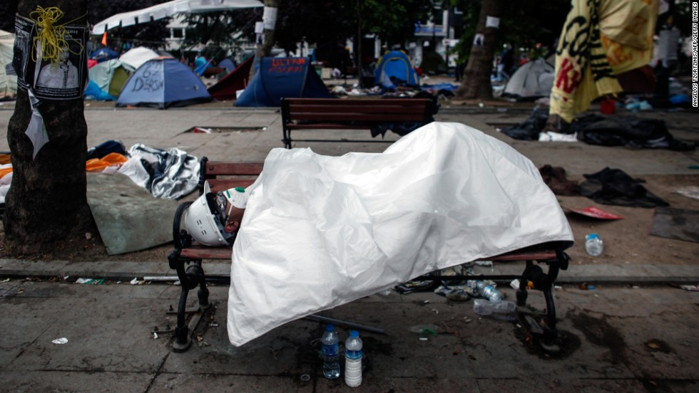 A man sleeps in Gezi Park in Istanbul's Taksim Square early on June 12, hours after riot police moved into the square in an attempt to push demonstrators out.