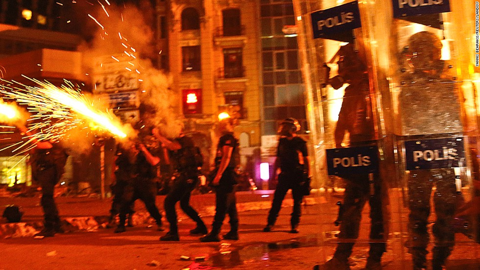 Riot police fire tear gas canisters at protesters in Taksim Square on June 11.