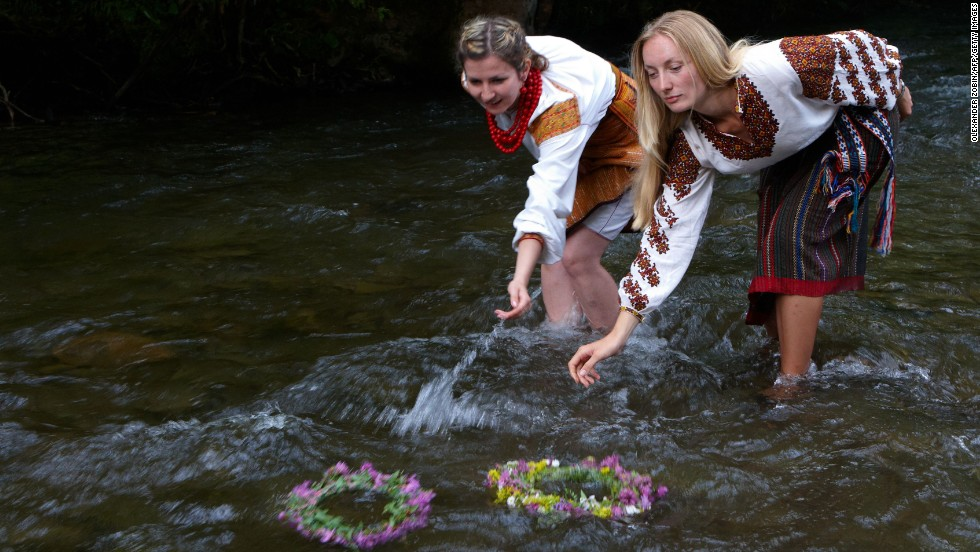 "In Eastern Europe the solstice celebrations fall on Ivan Kupala Day, a holiday that has romantic connotations for many Slavs, ""kupala"" is derived from the same word as ""cupid"". In Ukraine it is common for girls to put wreathes on a river to attract eligible bachelors."