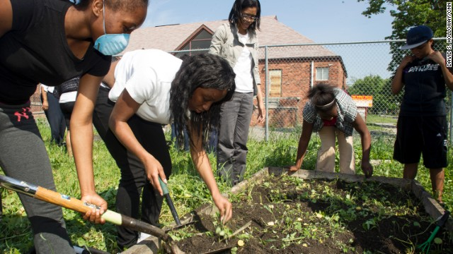 Catherine Ferguson Academy students weed raised beds and plant vegetables and herbs they'll later harvest and use to prepare meals. Their gardening day in May was interrupted by a protest against changes to the school's learning model.