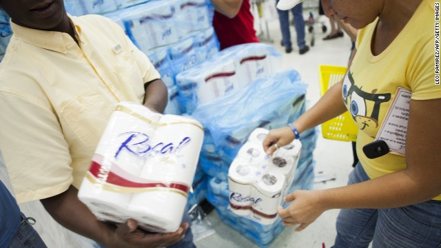 Consumers buy rationed goods during the inauguration of the state-owned Bicentenario supermarket in Caracas, on June 4, 2013. For almost a month there has been a shortage around the country of toilet paper due to a drop in its production and imports. AFP PHOTO/Leo RAMIREZ (Photo credit should read LEO RAMIREZ/AFP/Getty Images)