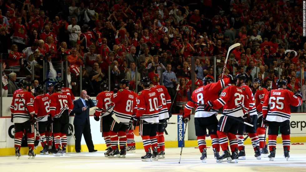 The Chicago Blackhawks celebrate after defeating the Boston Bruins 4-3 in triple overtime to win Game 1 of the NHL Stanley Cup Finals in Chicago on Wednesday, June 12. It was the fifth-longest game in Stanley Cup Finals history.