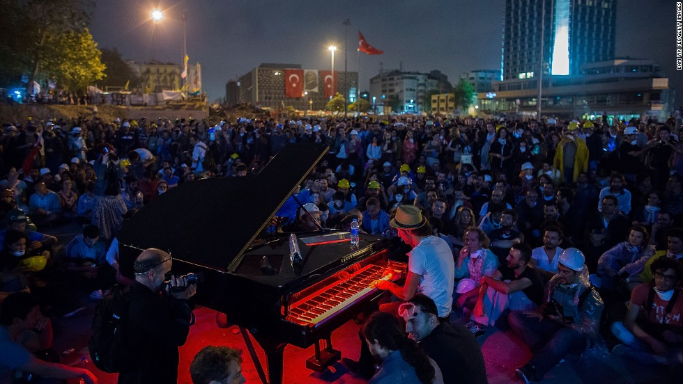 A man plays piano for hundreds of protesters in Taksim Square on Wednesday, June 12, in Istanbul.