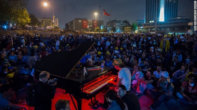 Protesters listen to a piano performance at Taksim Square on Tuesday in Istanbul, Turkey.