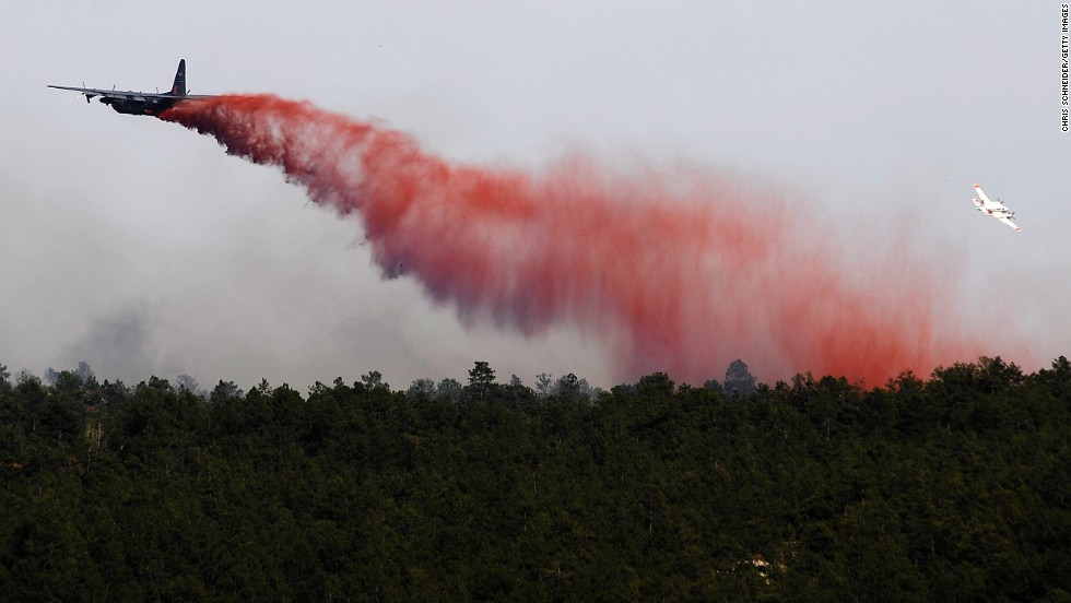 An airplane drops flame retardant over the Black Forest Fire on June 12 near Colorado Springs.