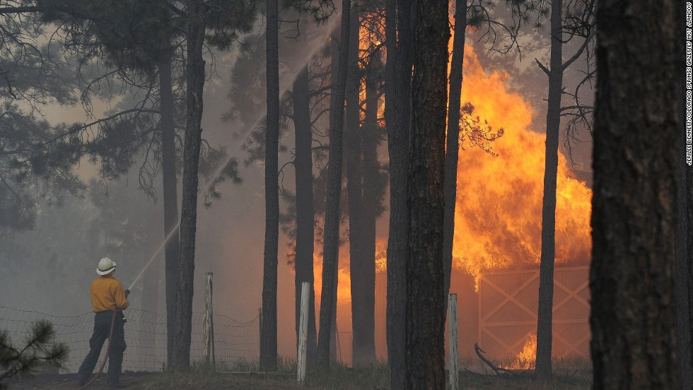 A firefighter fights a blaze near Black Forest, Colorado, on Wednesday, June 12. The Black Forest Fire is one of two major wildfires near Colorado Springs. The other, the Royal Gorge Fire, is threatening the Royal Gorge Suspension Bridge.