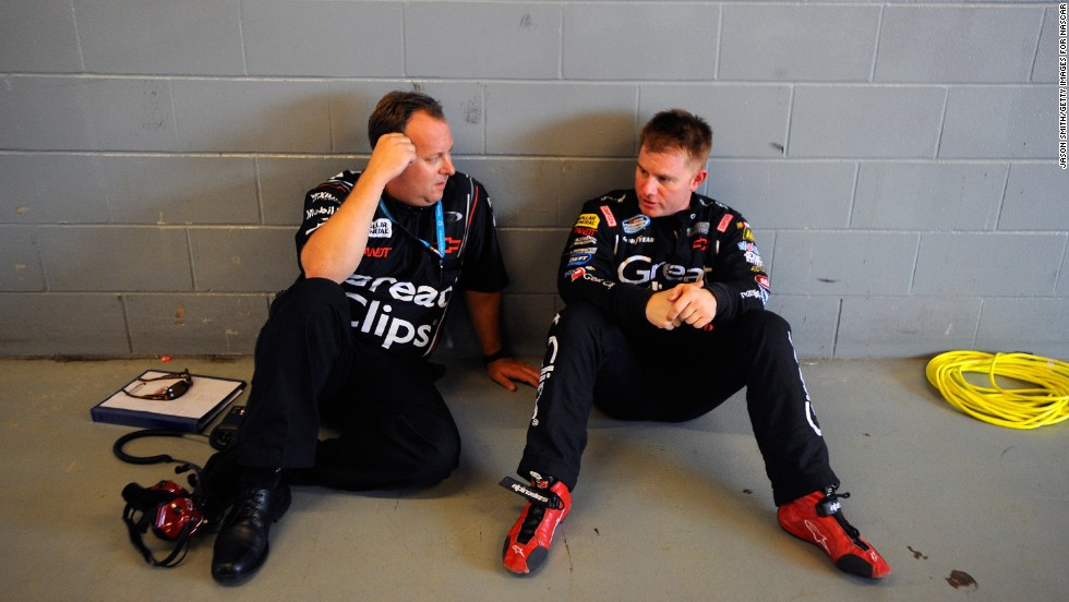 Leffler speaks with crew chief Eddie Pardue during practice for the NASCAR Nationwide Series US Cellular 250 at Iowa Speedway in Newton, Iowa, on August 5, 2011.