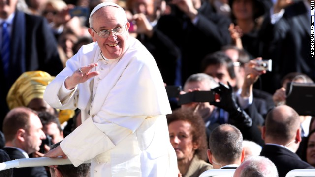 (File) Pope Francis waves to the crowd of faithful as he arrives in St. Peter's Square on March 19 in Vatican City.