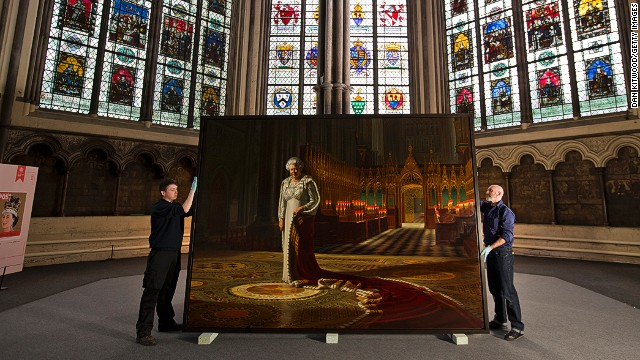 Art transportation workers hold a portrait of Queen Elizabeth II on May 17 before it is moved into Westminster Abbey.