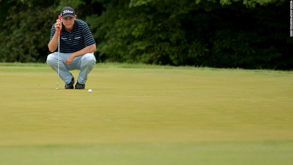 Bill Haas of the United States ponders a putt on the 10th hole on June 13.