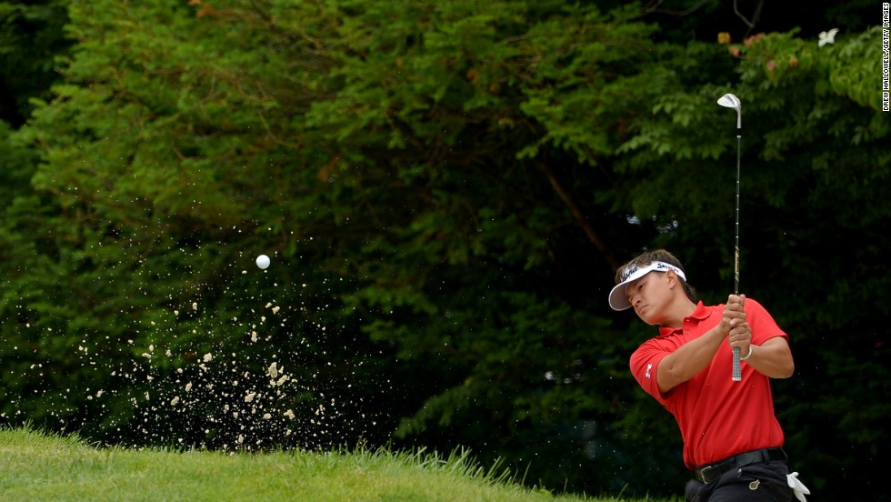 Ryan Yip of Canada hits his second shot out of a bunker on the 10th hole on June 13.