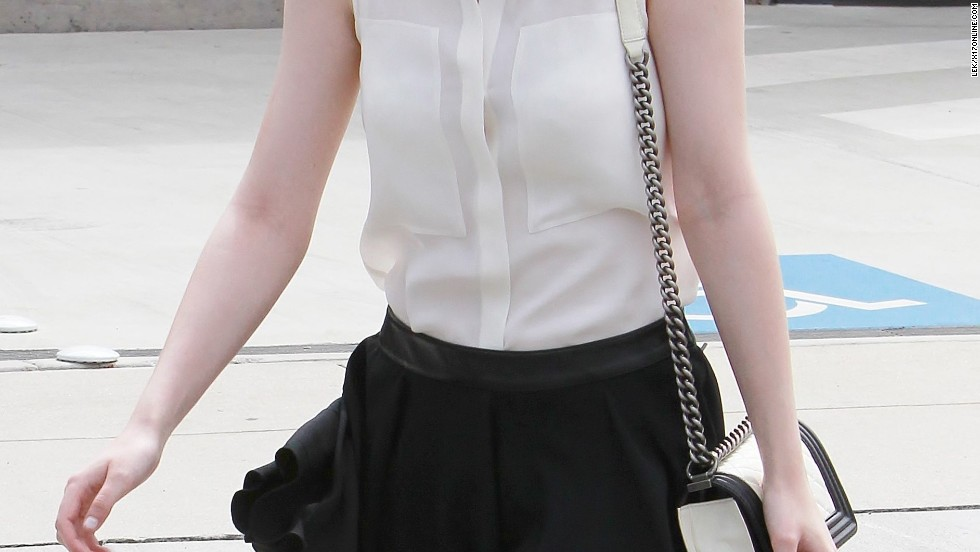 Dakota Fanning looking grown up in black and white heading to a meeting in Santa Monica, California.