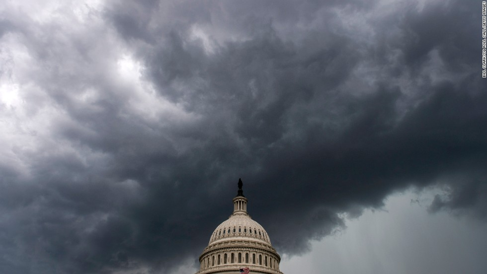 A strong line of thunderstorms approaches the Capitol with heavy rain and winds on Thursday, June 13, in Washington.