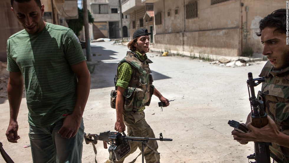 "Syrian rebels leave their position in the northwestern town of Maaret al-Numan on Thursday, June 13. The White House said that <a href=""http://www.cnn.com/2013/06/13/politics/syria-us-chemical-weapons/index.html"">the Syrian government has crossed a ""red line""</a> with its use of chemical weapons and announced it would start arming the rebels."