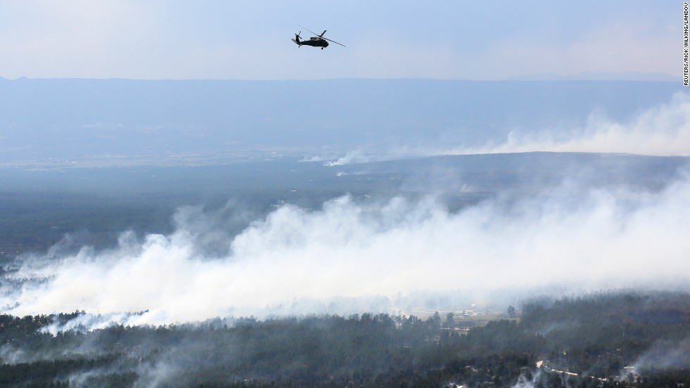 A Blackhawk helicopter patrols over the Black Forest Fire on June 13.