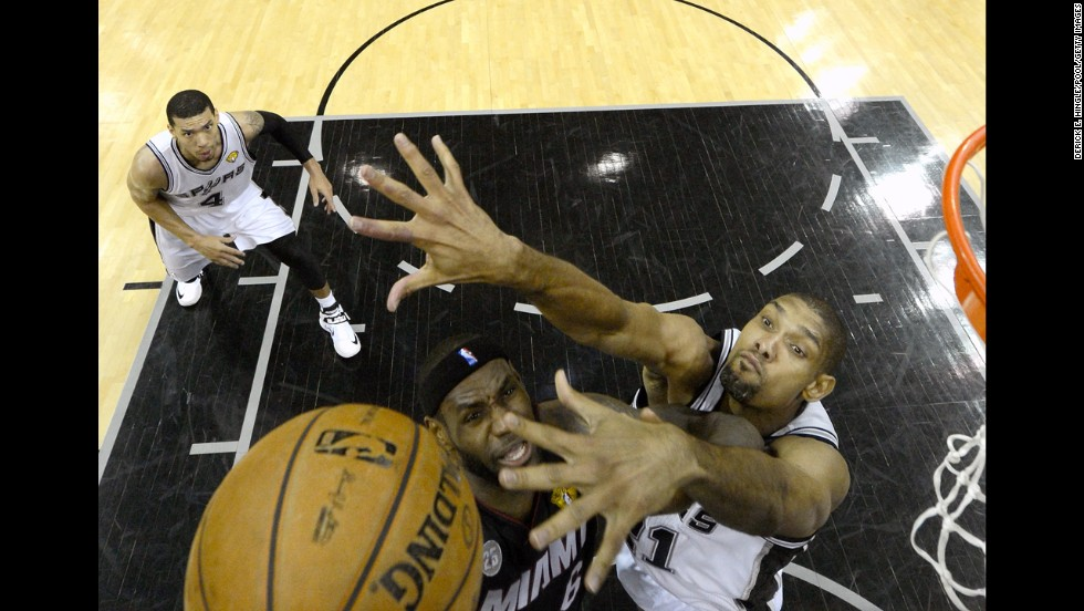 LeBron James of the Miami Heat goes up for a shot against Tim Duncan during the first half.