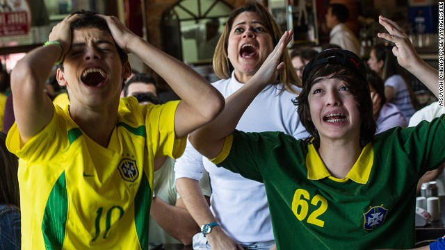 Brazilian football fans react as they watch on TV the London 2012 Olympic Games men's football final match between Brazil and Mexico in Sao Paulo, Brazil on August 11, 2012. Mexico won 2-1. AFP PHOTO/Yasuyoshi CHIBA (Photo credit should read YASUYOSHI CHIBA/AFP/GettyImages
