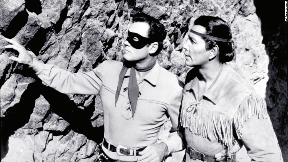 Moore and Silverheels scope out the situation as The Lone Ranger and Tonto.