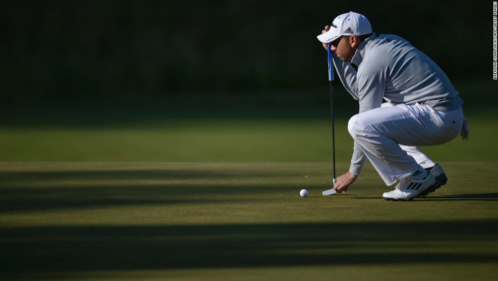 Sergio Garcia of Spain places a ball on the 17th green on June 15.
