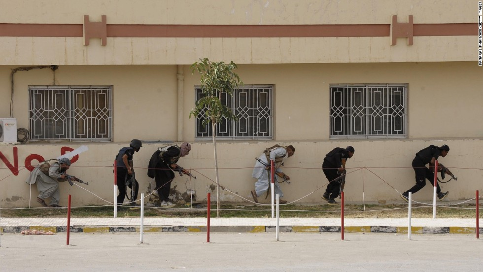 Pakistani paramilitary soldiers take positions after militants attacked a hospital in Quetta, Pakistan, on Saturday, June 15. Several militants held hundreds of people hostage inside the Bolan medical complex.