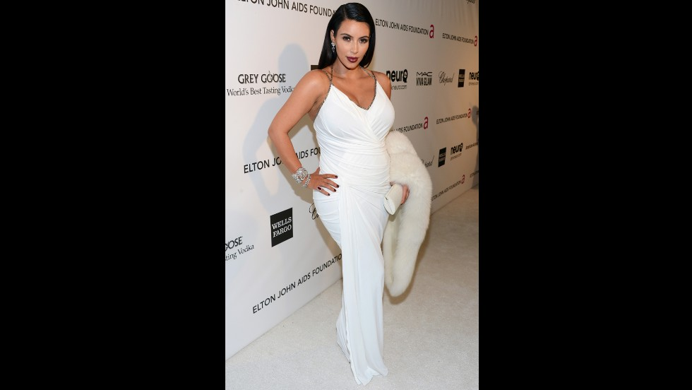 Kim Kardashian dresses her bump in white for the Elton John AIDS Foundation's Academy Awards viewing party in February.