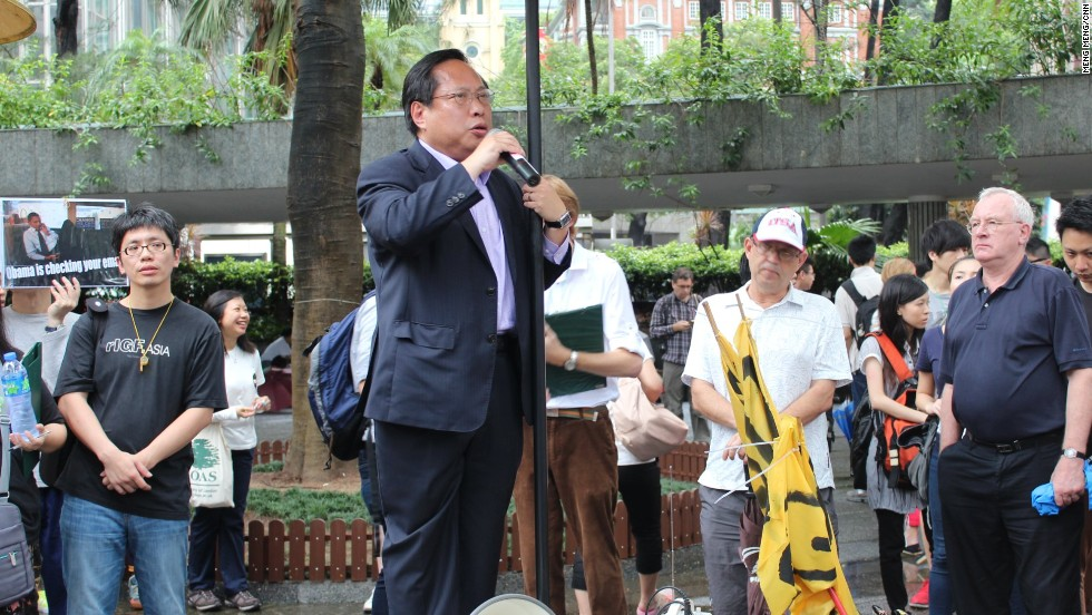 "Standing in Chater Garden in the city's business district, Hong Kong legislator Albert Ho said the protest was a ""march for justice."""
