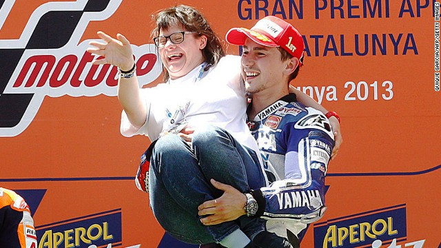 Jorge Lorenzo celebrates with Anna Vives, a friend with Downs Syndrome who designed a special helmet for him.