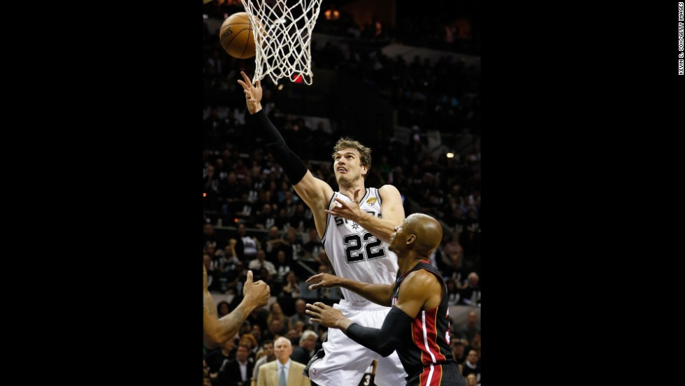 Tiago Splitter of the San Antonio Spurs shoots over Ray Allen of the Miami Heat.