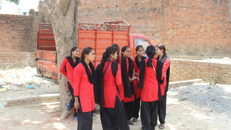 "In their distinctive uniforms, the girls patrol their local streets looking out for males acting ""inappropriately"" towards girls and women -- a risky undertaking in a male-dominated society."