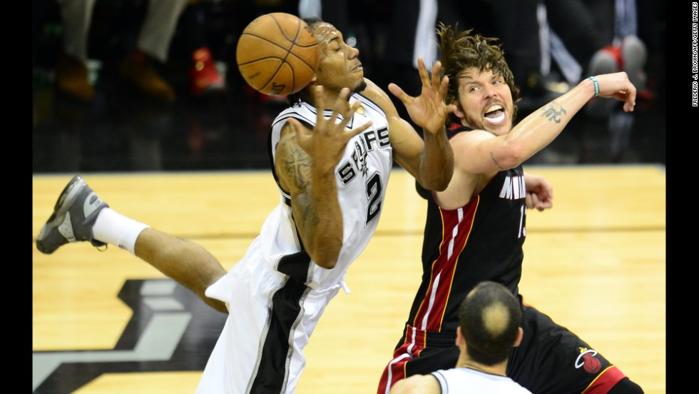 "Kawhi Leonard of the San Antonio Spurs vies for the ball with Mike Miller of the Miami Heat on Sunday, June 16. The Spurs won Game 5 and lead the series 3-2. <a href=""http://www.cnn.com/2013/06/13/worldsport/gallery/nba-finals-game-4/index.html"">See photos from Game 4.</a>"