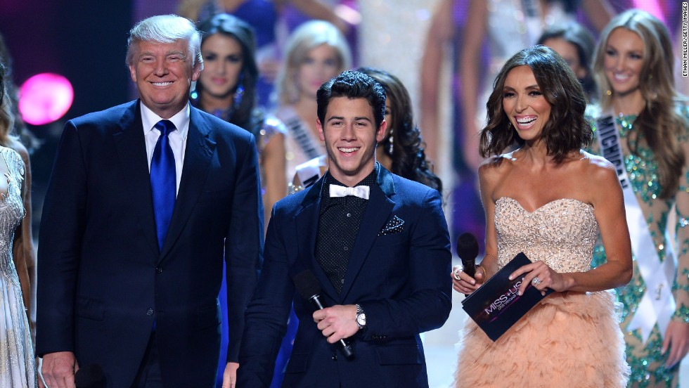Donald Trump, co-owner of the Miss Universe Organization, joins hosts Nick Jonas and Giuliana Rancic.