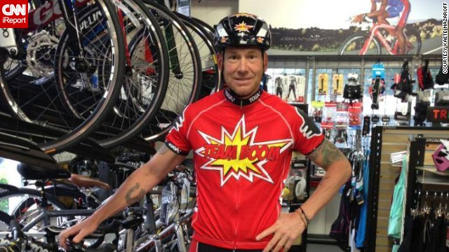 "Dave Nazaroff in his bike shop in a ""Team Boom"" T-shirt he and his wife designed for the charity bike ride."