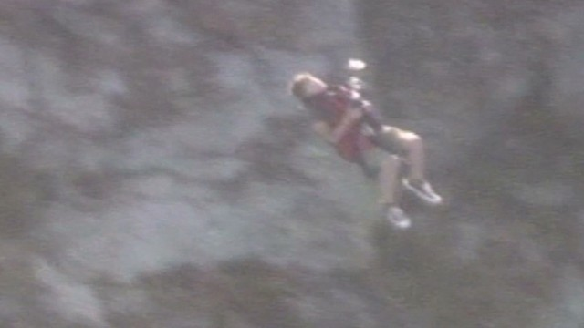 Watch boys' risky rescue on steep cliff
