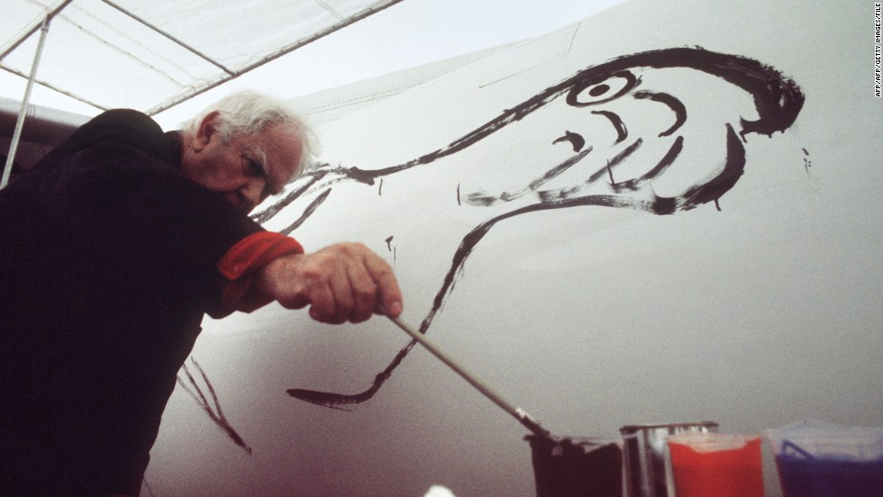 U.S. painter and sculptor Alexander Calder, credited as the creator of hanging wire mobiles, paints a bird on a fuselage of a Braniff jetliner on May 29, 1975 at the Paris Airshow.