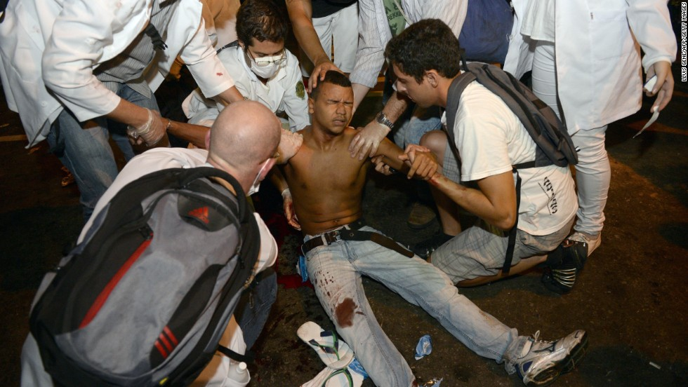 A protester receives assistance after being shot in the leg in Rio de Janeiro on June 17.