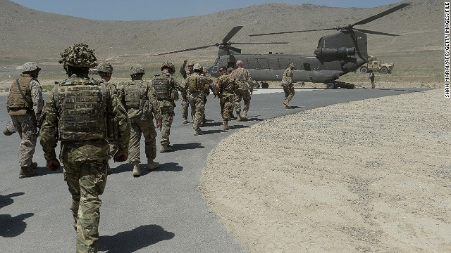 NATO soldiers board a Chinook helicopter after a security handover ceremony at a military academy outside Kabul on June 18, 2013.