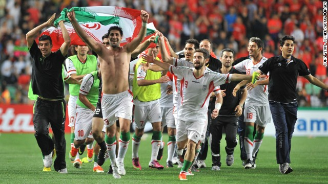 Iran's players celebrate after beating South Korea 1-0 to reach the 2014 World Cup.