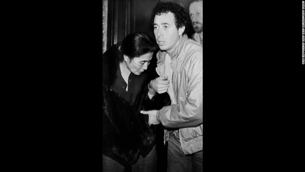 Yoko Ono is helped by David Geffen as she leaves Roosevelt Hospital after learning of the death of her husband.