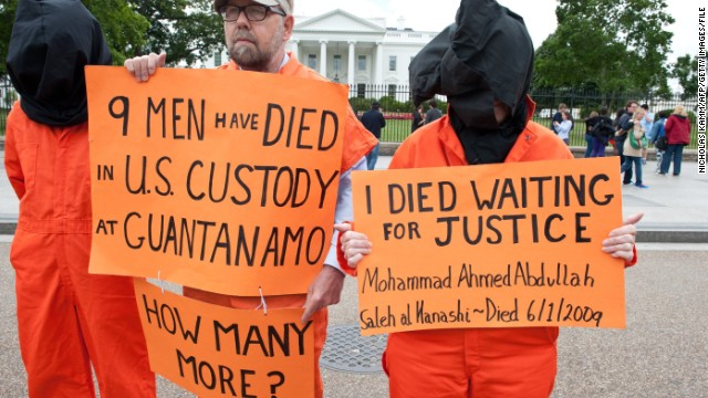 Protresters demanding the closing of the Guantanamo detention facility and the end of the ongoing hunger strike by 103 of the inmates stand outside the White House in Washington on May 24, 2013.