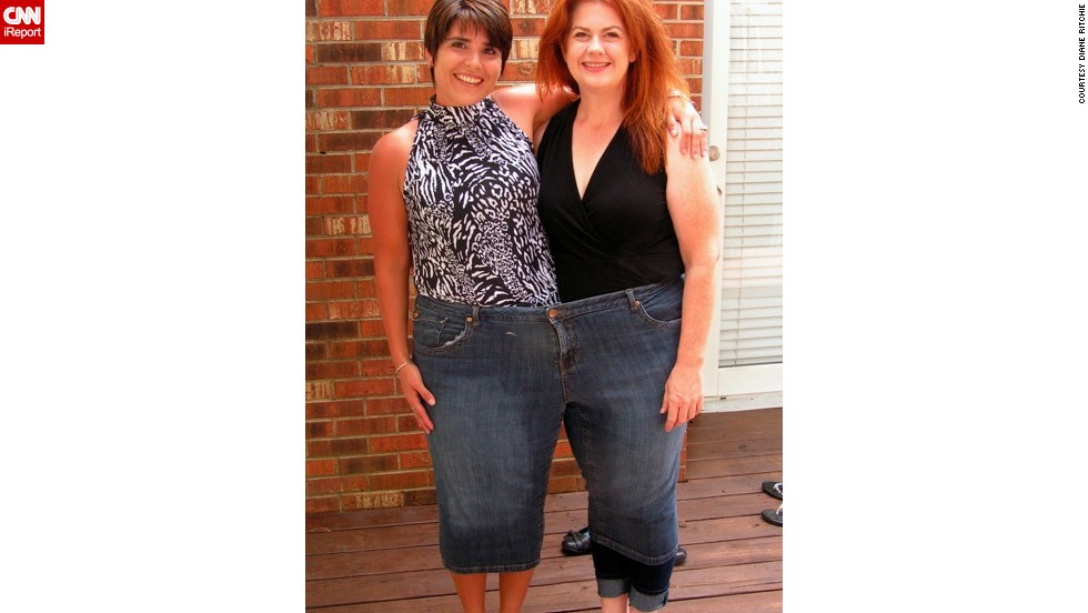 "Ritchie, left, and Moyer try on a pair of Moyer's ""before"" jeans -- size 28 -- on Father's Day. The two friends have lost more than 280 pounds together in 2½ years."