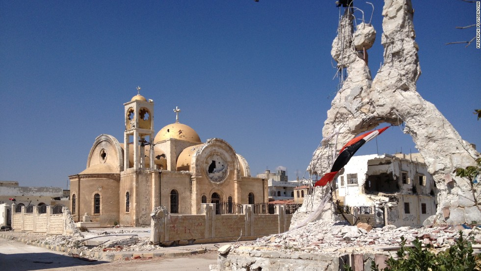 The city's only church was badly damaged by the fighting. Some of the icons and paintings inside were also defaced -- the Syrian army blames Islamist rebels.