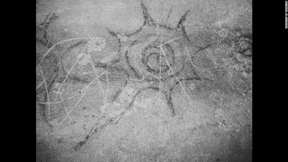 A cross? A comet? A star? This symbol, found in Dunbar Cave in Clarksville, Tennessee, is commonly seen in religious iconography from the 1300s.